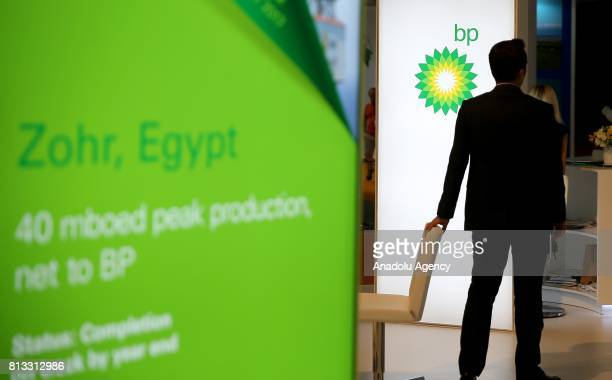 A man stands in front of 'British Petroleum' logo during the 22nd World Petroleum Congress at Lutfi Kirdar International Convention and Exhibition...