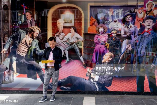 Man stands in front of Cameron Mackintosh's Gieldgud Theatre on Shaftesbury Avenue in London's West End Theatreland, closed for the foreseeable...