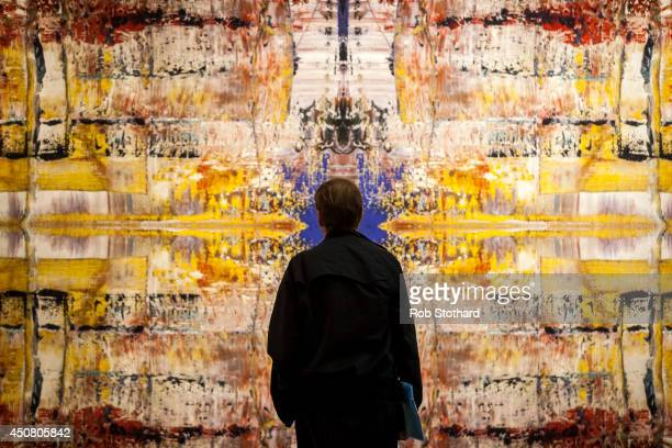 Man stands in front of Gerhard Richter's 1932 piece Abdu, estimated to sell for £500,000-£700 on display at Sotheby's auction house on June 18, 2014...