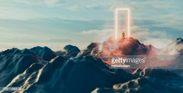 man stands in front of glowing portal and is about to enter the unknown - spirituality stock pictures, royalty-free photos & images