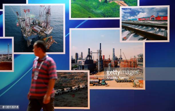 A man stands in front of petroleum site images during the 22nd World Petroleum Congress at Lutfi Kirdar International Convention and Exhibition...