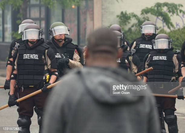 A man stands in front of police as they hold a line on the fourth day of protests on May 29 2020 in Minneapolis Minnesota The National Guard has been...