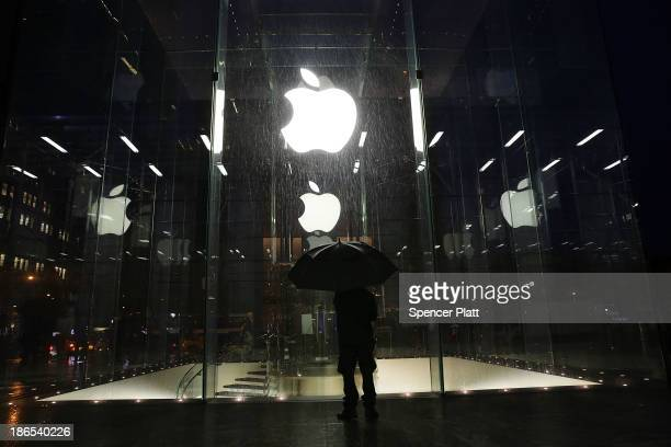 A man stands in front of the Apple Store before it opened on the day the company will sell their new iPad Air the fifth generation of its tablet on...