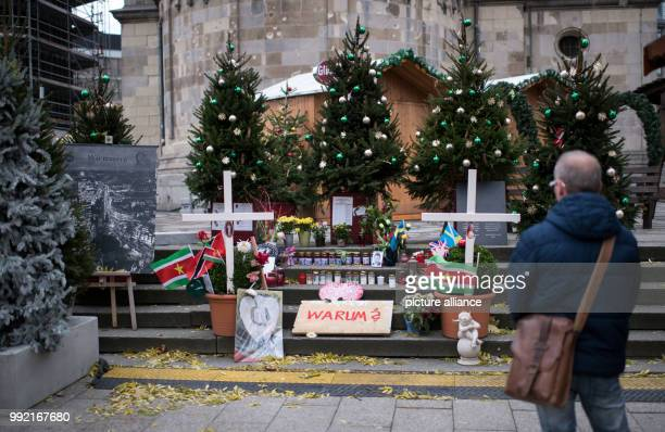 A man stands in front of the improvised memorial site on the Christmas market at the Kaiser Wilhelm Memorial Church in Berlin Germany 24 November...