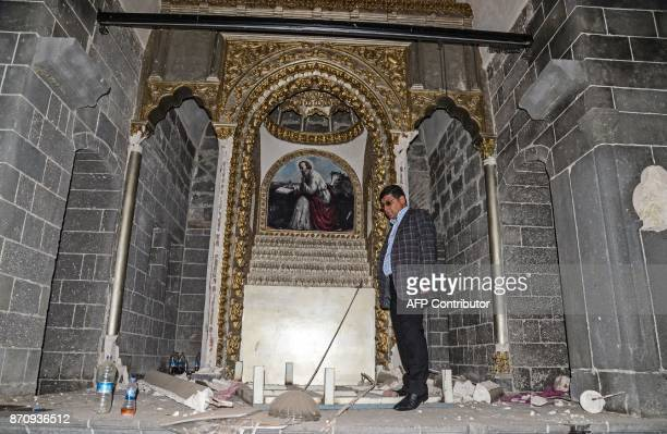 A man stands in the damaged naive of the Surp Giragos Armenian church in the historical Sur district of the Kurdishmajority city of Diyarbakir...