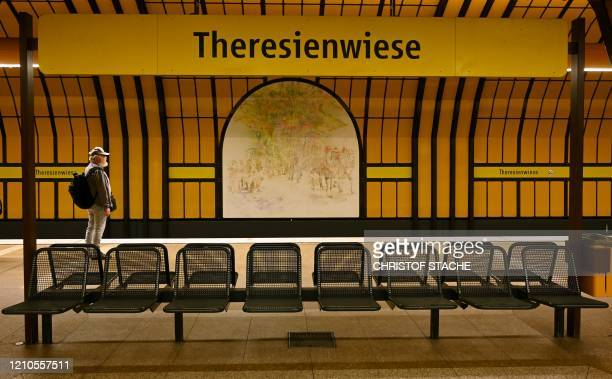 """Man stands in the empty underground station """"Theresienwiese"""", near where the Oktoberfest beer festival usually takes place in Munich, southern..."""