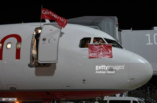 A man stands in the open door of Air Berlin flight AB 6210 before departing for Berlin at Munich International Airport on October 27 2017 near Munich...