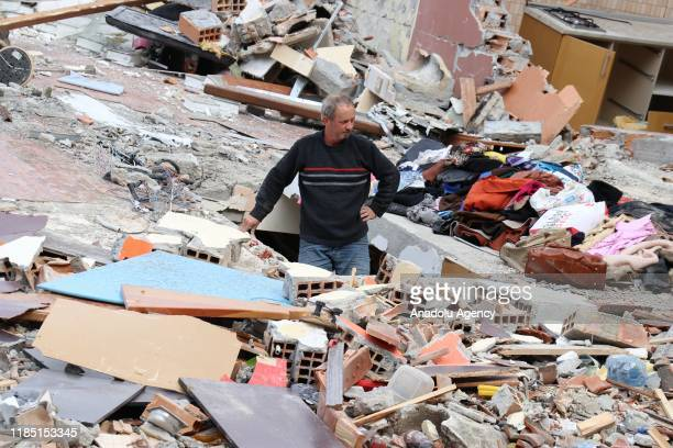 Man stands in the rubble of a collapsed building after a 6.3-magnitude earthquake hit Albania's Durres city on November 28, 2019. Albania has been...