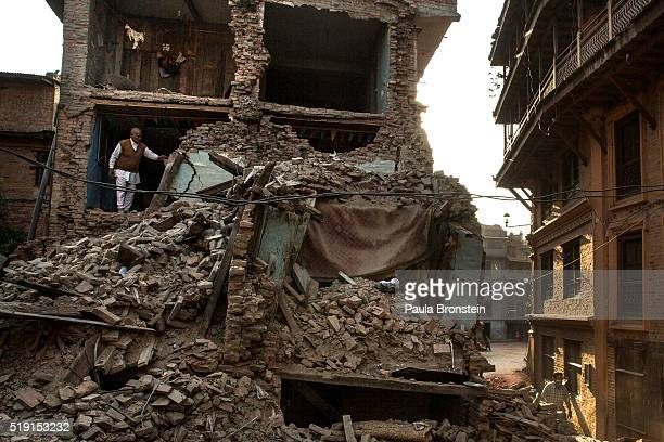 Man stands in the rubble of his home in Bhaktapur on May 5, 2015 where most of the old city has been flattened. So far more than 7,000 people have...