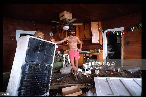 A man stands in the ruined interior of a room September 27 1989 in South Carolina Hugo is ranked as the eleventh most intense hurricane to strike the...