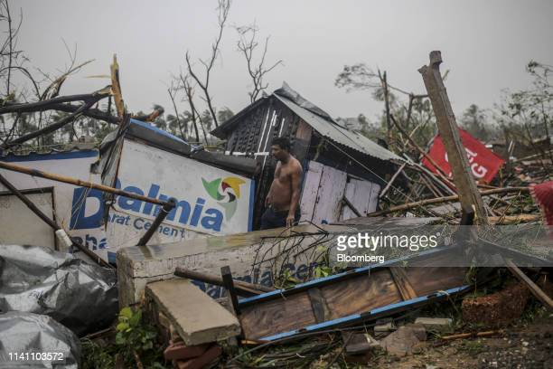 A man stands in the wreckage of his house after Cyclone Fani passes in the Puri district of Odisha India on Friday May 3 2019 A category 4 storm with...