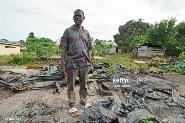 Man stands in what is left of his house on May 11, 2019 that was burnt down by Cameroonian military forces in January 2019 near Buea,Cameroon. In...