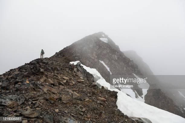 man stands in whiteout on cooper mountain, kenai peninsula, alaska - kenai mountains stock pictures, royalty-free photos & images