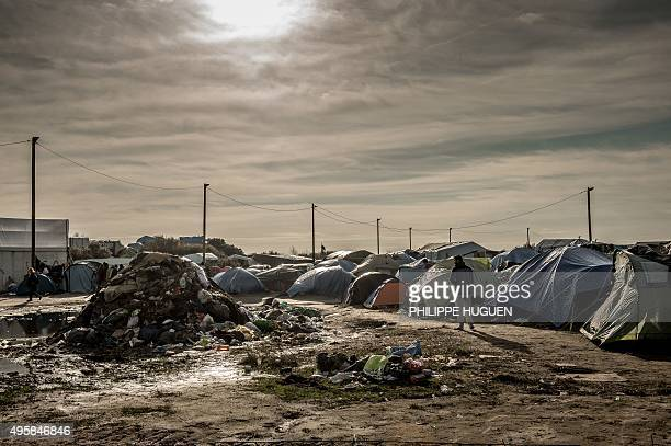 A man stands near tents on November 5 2015 in the Jungle migrants camp in Calais A French court on November 2 ordered the state to improve conditions...
