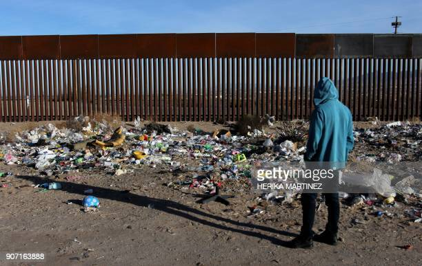 A man stands near the border wall between Mexico and the United States in Ciudad Juarez Chihuahua state Mexico on January 19 2018 The Mexican...