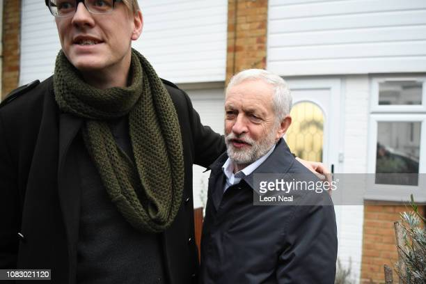 A man stands near the Leader of the Labour Party Jeremy Corbyn as he leaves his home ahead of The Meaningful vote today at Parliament on January 15...
