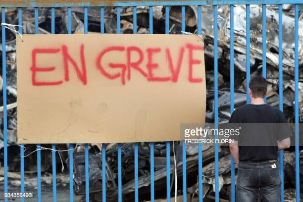 'On strike' as strikers from ArcelorMittal in Gandrange eastern France block the entrance of the plant on May 16 asking for negotiations on the...