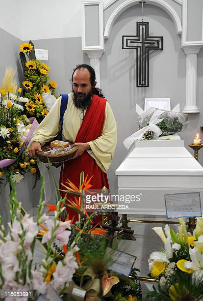 A man stands next to a coffin holding the remains of Ana Fabricia Cordoba Cabrera on June 8 in Medellin Antioquia department Colombia Cordoba a...