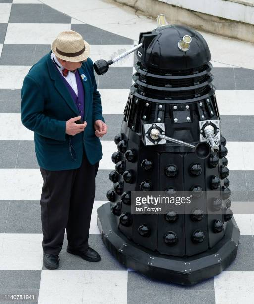 Man stands next to a Dalek on the first day of the Scarborough Sci-Fi weekend at the seafront Spa Complex on April 06, 2019 in Scarborough, England....