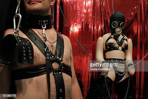 A man stands next to a fetish exhibition stand at The International Specialized XSHOW Exhibition for Adults 2010 on May 2010 in Moscow Russia The 3rd...