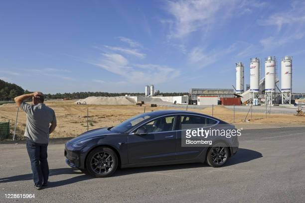 Man stands next to a Tesla Model S automobile at the Tesla Inc. Gigafactory site in Gruenheide, Germany, on Sunday, Sept. 20, 2020. The plant that...
