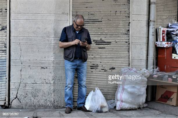 A man stands next to a wall near a bazaar during the Muslim holy fasting month of Ramadan in the historic Ulus district of Ankara Turkey on May 27...