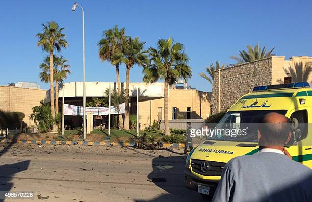 A man stands next to an ambulance outside the Swiss Inn hotel in the Egyptian town of ElArish in the Sinai peninsula following an attack on the hotel...