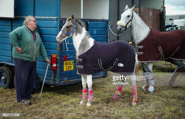 A man stands next to his horses during the 194th Sedgefield Show on August 12 2017 in Sedgefield England The annual show is held on the second...
