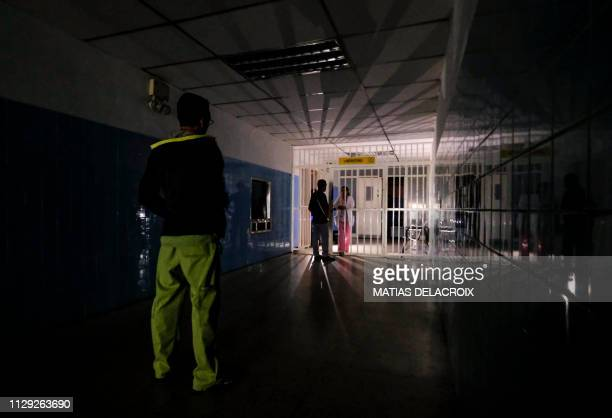 A man stands on a dark corridor at Miguel Perez Carreno hospital in Caracas during the worst power outage in Venezuela's history on March 8 2019...