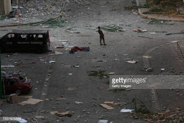 Man stands on a debris-strewn street after a huge explosion a day earlier, on August 5, 2020 in Beirut, Lebanon. As of Wednesday morning, more than...