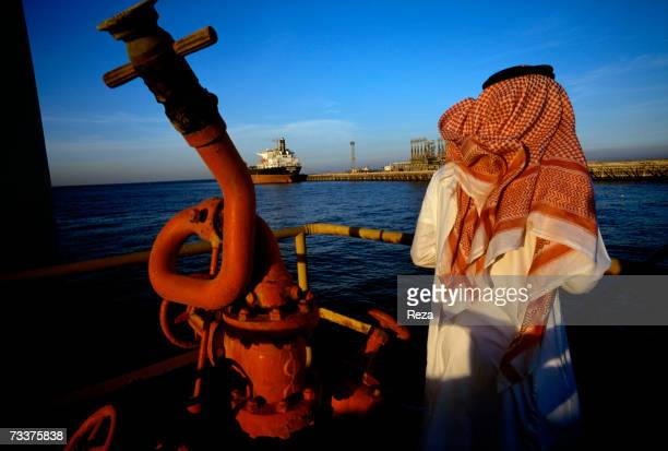 A man stands on a platform on an oil and gas terminal on January 2003 in n the Persian Gulf off of Ras Al Tanoura Saudi Arabia