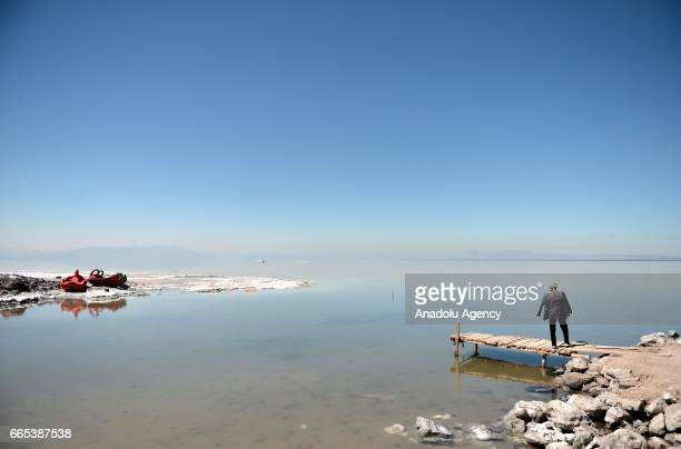 A man stands on a small pier at Urmia Lake in Urmia Iran on April 6 2017 Urmia Lake was the largest lake in the Middle East and the sixthlargest...
