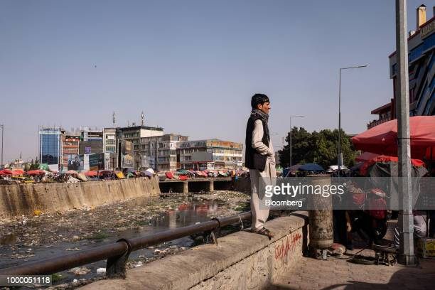A man stands on a wall at the banks of the Kabul River in Kabul Afghanistan on Thursday July 12 2018 US President Donald last year said 16000 US...