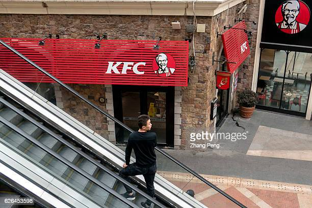 A man stands on an escalator past a KFC restaurant As the largest restaurant chain in China with more than 7000 outlets KFC makes new strategy...