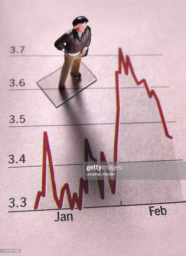 Man stands on Financial graph : Stock Photo