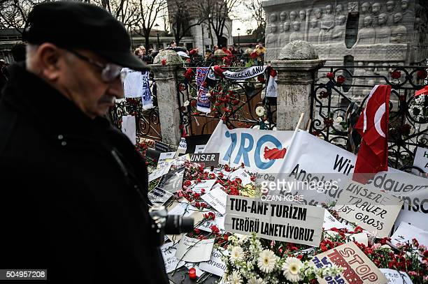 A man stands on January 14 2016 in front of a makeshift memorial with flowers candles A turkish flag placards and German national and Bundesliga team...