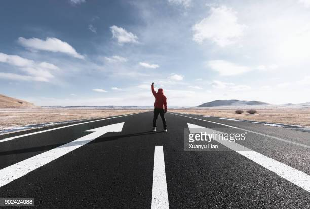 man Stands On Long Road