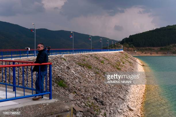 A man stands on the banks of the Gazivode lake in northern Mitrovica on September 8 2018 Controlled by Serbs but a power source for Kosovo the...