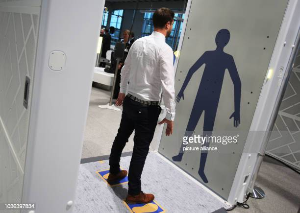 A man stands on the control surface Easy Security in a full body scanner in Cologne Germany 15 November 2016 Authorities and air travel companies...