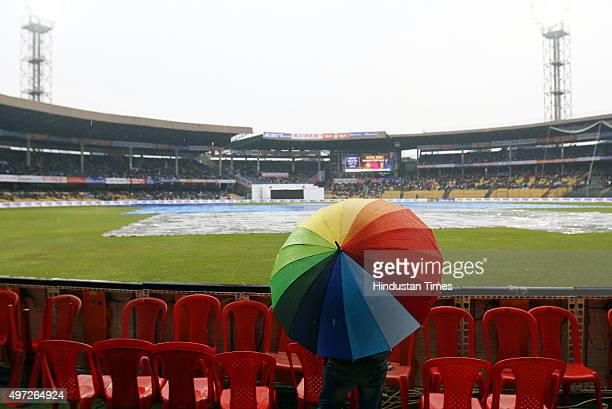 A man stands on the ground during rain on the 2nd day of 2nd Test match between India and South Africa at M Chinnaswamy Stadium on November 15 2015...
