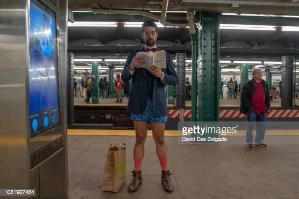 Man stands on the platform of the West 4th, F subway line during the 18th annual No Pants Subway Ride on January 13, 2019 in New York City. 24 cities...