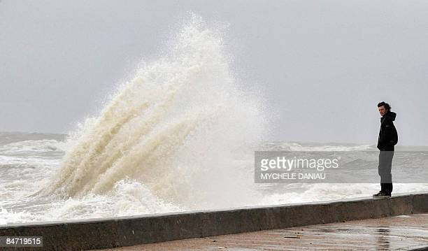 A man stands on the seafront on February 10 2009 in VersurMer western France as hurricaneforce gusts up to 140 kilometres per hour were recorded on...