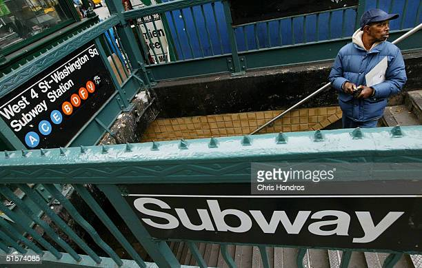 A man stands on the steps of the West 4th Street subway station October 26 2004 in New York City The New York City subway system opened 100 years ago...