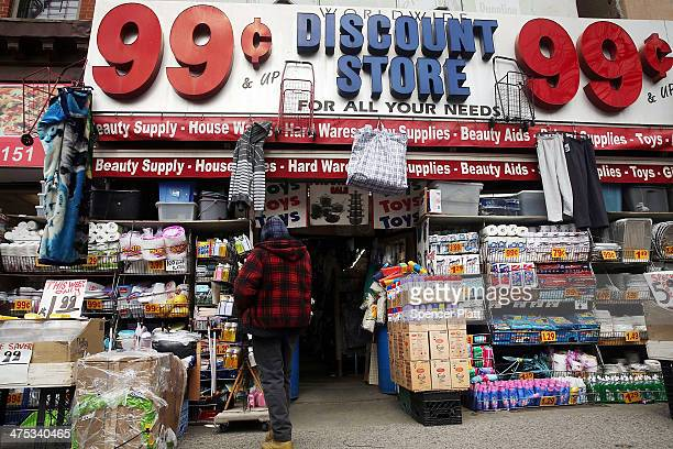 A man stands outside a discount store in the Fort Greene neighborhood where the director and artist Spike Lee once lived on February 27 2014 in the...