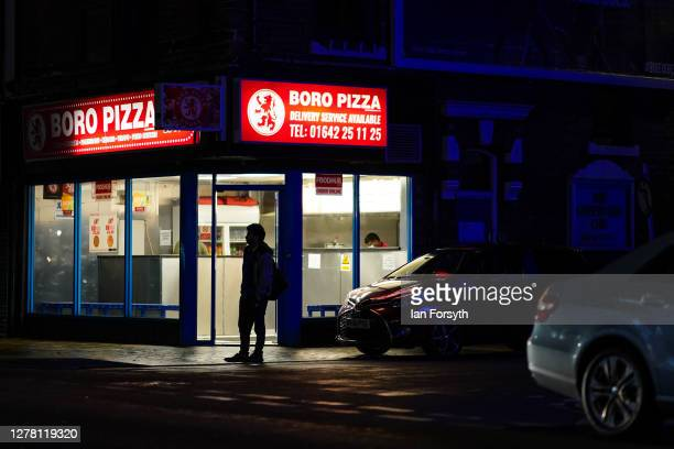 A man stands outside a pizza shop on Linthorpe Road on October 02 2020 in Middlesbrough England The mayor of Middlesbrough Andy Preston is leading a...