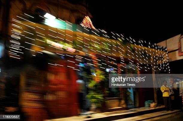Man stands outside a temple on August 28, 2013 in Ayodhya, India. Three days after Vishwa Hindu Parishad field Parikarma attempt, Ayodhya saw a heavy...