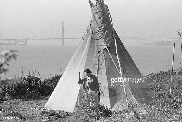 A man stands outside a tepee set up on Alcatraz during the American Indian Movement's takeover of the federal penitentiary Behind him the Golden Gate...