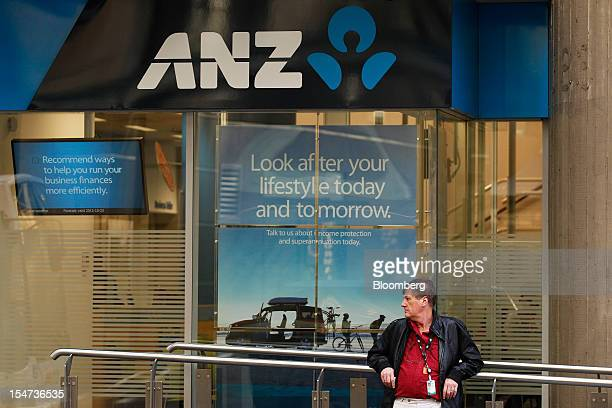 A man stands outside Australia New Zealand Banking Group Ltd's George Street branch in Sydney Australia on Tuesday Oct 23 2012 Treasurer Wayne Swan...