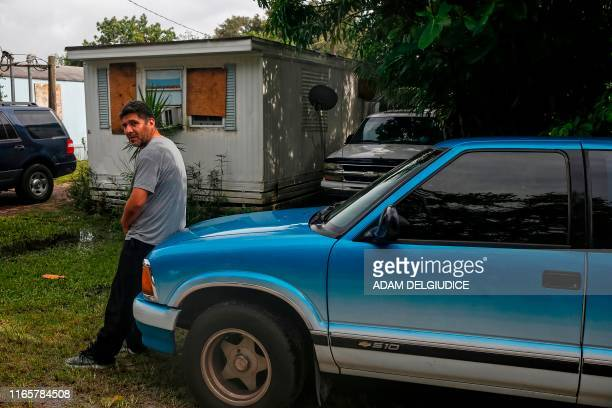 Man stands outside his trailer at The Manatee Mobile Home & RV Park in Fort Pierce, Florida on September 2, 2019. - Monster storm Dorian stalled over...