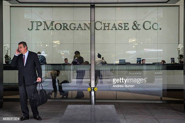 Man stands outside JP Morgan Chase's corporate headquarters on August 12, 2014 in New York City. U.S. Banks announced second quarter profits of more...